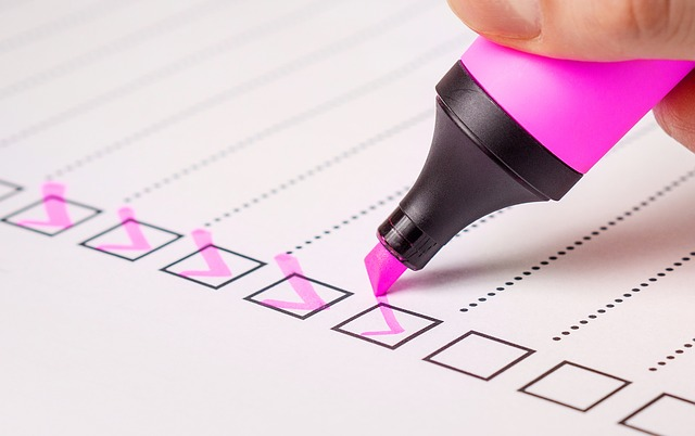 Pink highlighter checking off todo list boxes