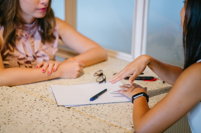 A woman being mentored by a mentor