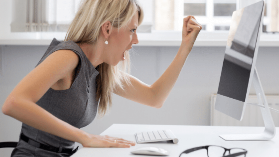 Woman yelling at someone on a computer